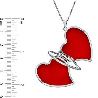 Tilted Heart Footprints Locket in Sterling Silver | Tuggl