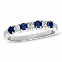 Blue Sapphire and 1/7 CT. T.W. Diamond Seven Stone Wedding Band in 14K White Gold
