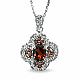 Oval Garnet and 1/3 CT. T.W. Enhanced Red and White Diamond Pendant in Sterling Silver