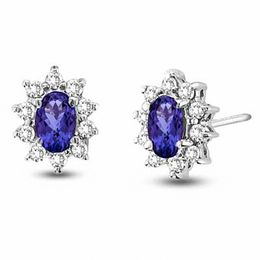 Oval Tanzanite and 1/3 CT. T.W. Diamond Frame Stud Earrings in 14K White Gold