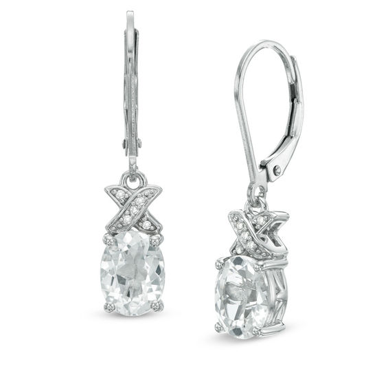 Oval White Topaz And Diamond Accent X Earrings In Sterling Silver