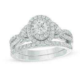 Celebration Grand® 1-1/5 CT. T.W. Diamond Layered Oval Frame Crossover Bridal Set in 14K White Gold (I/I1)
