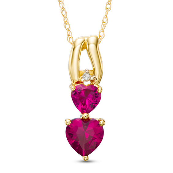 Zales Heart-Shaped Lab-Created Ruby and Diamond Accent Three Heart Pendant in 10K Gold P4BqmoQ