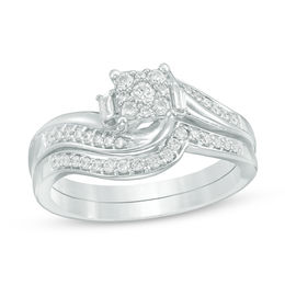 1/3 CT. T.W. Composite Diamond Bypass Swirl Bridal Set in 10K White Gold