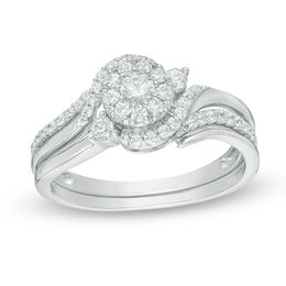 1/2 CT. T.W. Diamond Swirl Bypass Frame Bridal Set in 10K White Gold