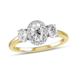 1/3 CT. T.W. Oval Diamond Frame Three Stone Engagement Ring in 10K Gold