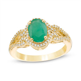 Oval Emerald and 1/5 CT. T.W. Diamond Frame Scrolling Split Shank Ring in 10K Gold